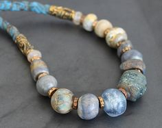 Artisan lampwork and ceramic beads necklace with silk / Blue and  sand tones / Organic design