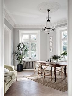 This light turn of the century home looks so fresh and clean, but at the same time has a very cozy look because of the different tints of wood that are used throughout the space. The dining table is p
