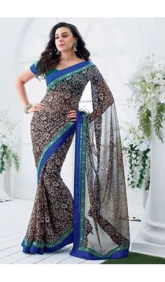 Grace yourself by draping in this Black #chiffon #brasso printed #casual wear #saree with trendy and #elegant print on it. The saree is an ideal choice of attire for casual events and comes attached with matching blouse piece that can be custom made for upto bust size of 42 inches.