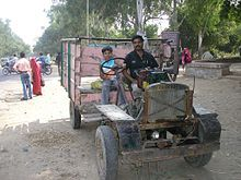 In India I saw one of theses strange vehicles about 17 years ago. It is actually a truck made by the local carpenter or blacksmith and is driven by an irrigation pump motor. Generally it is called Jugad.