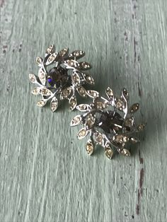 A personal favorite from my Etsy shop https://www.etsy.com/listing/605166657/vintage-rhinestone-earrings-vintage-clip