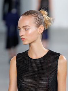 T's Daily Do: Slicked-Back Buns at Calvin Klein. NYFW Spring 2015 (Photo: Firstview)