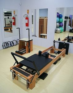 Designing your rooms using pilates equipment can be innovative, exciting and frightening. This kind of equipment does not look like any home gym, or exercise equipment. In this picture: The Wunda chair Mirrors Swiss balls The reformer