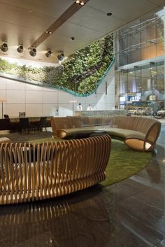 Hotel ICON, CL3 Architects Limited, world architecture news, architecture jobs. Living wall behind desk or accent wall at elevator lobby.