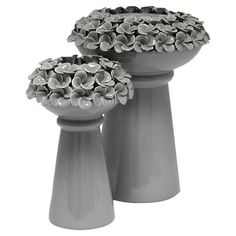 Set of 2 ceramic pedestal-style candleholders with textured petal details.   Product: Small and large candleholderC...