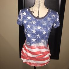 American Flag scoop neck shirt with crystals. American Flag scoop neck shirt with crystals. It's a really think slinky material with clear crystals. Smoke free home. Tops Tees - Short Sleeve