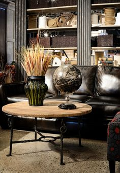  Some of the  incredible items from Cornerstone Home Interiors. Leather Sofa $2039.00 Round reclaimed Coffee Table $725
