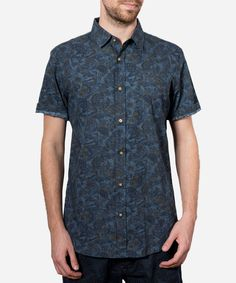 #Blue #shirt with contrasting #buttons and fantastic #print on whole #Fabric. This is a team favorite.  Short #Sleeve All Over #Print #Button Down Shirt #Fabric Content: 100% #Cotton Made In China  #Fashion #Menswear #Style #Shop #Shopping #Top #Collection #Label #Brand #Designer  #Appare #Male #Mens #Clothing #Clothes  #summer #spring