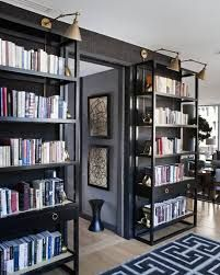 We could do bookshelves if we can't do built-ins. I like the open shelves with book ends. Lighting over bookshelves is pretty. Black Rooms, Black Walls, Home Theaters, Black Bookcase, Black Shelves, Open Shelves, Bookcase Wall, Shelving Units, Metal Bookcase