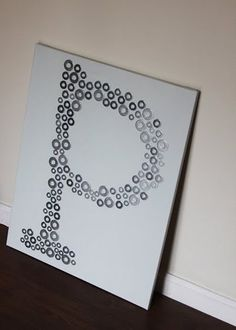 Washer Wall Art - great idea for a modern room//The washers could be painted in a color to coordinate with your room using metallic spray paint and adhere onto contrasting board.