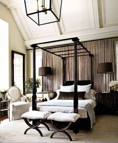 Stunning focal wall, bed and color scheme in this bedroom.