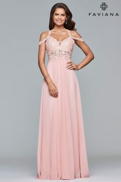 Soft and sultry in Faviana 10006. A swirling chiffon skirt is topped by a sweetheart neckline top, featuring straps that go over the shoulder and a second strap off the shoulder. The matching lace top has illusion panel that wraps around to the back covered in sparkling accent jewels. A sweet choice for your next prom, wedding, or military ball.