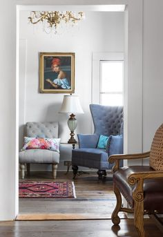 A framed print of Creole in a Red Turban, painted by Jacques Aman in 1840, is the first thing you see when you enter the sitting room.