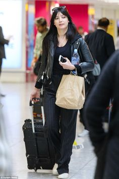 Natural beauty: Daisy Lowe opted to go make-up free as she arrived back in London on Frida...