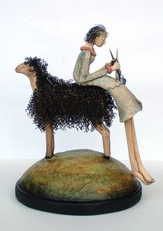 a knitter and her sheep - sculpture by Kathleen Stoltzfus
