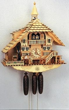 Model #8TMT 1071/0 Chalet Cuckoo Clock with Animated Wood-chopper and Bell Tower, Natural Wood Color.