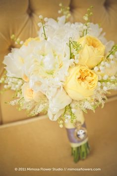 Dreamy yellow, ivory and cognac bouquet.  Garden roses, white hydrangeas, tulips, lily of the valley and peonies..