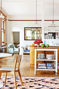 Home Tour: A Fashion Designer's Airy SoHo Loft // kitchen, butcher block cart, Moroccan Azilal rug, open-plan kitchen