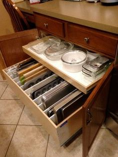 Your Pin of the Week: A deep drawer with dividers that houses cutting boards, cookie sheets and muffin tins. And a top shelf with easy access to shallow baking dishes. Brilliant!
