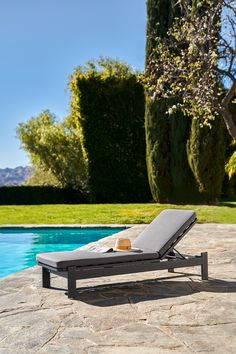 An aluminum base holds up a weather-resistant cushion, cut from dense foam. Water and sag proof? This lounger does it all. #OutdoorFurniture #OutdoorLoungeChair #PatioFurniture #OutdoorStyle Hold Ups, Lounge Chairs, Cushion Cut, Cushions, Weather, Base, Outdoor Furniture, Grey, Modern