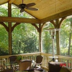 Gabled roof screened porch with cedar arches in Mountain Brook, AL