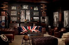 Gallery wall of boxing memorabilia with union jack sofa