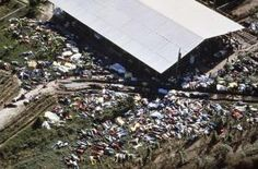 The Jonestown Massacre - Bodies lie around the compound of the People's Temple in Jonestown, Guyana on November More than 900 members of the cult led by Rev. Jim Jones died from cyanide poisoning. It was the largest mass suicide in modern history. Jonestown Massacre, Creepy History, Creepy Photos, Haunting Photos, Scene Photo, Historical Pictures, Aerial View, Old Photos, Famous Photos