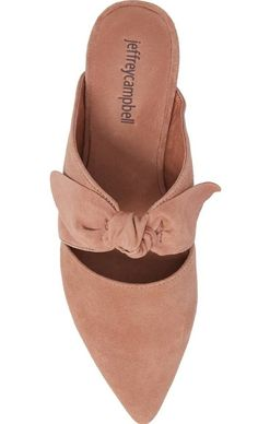 A tiny stacked heel adds just the right amount of lift to this pointy-toe mule crafted from supple suede and topped with a casually knotted bow.