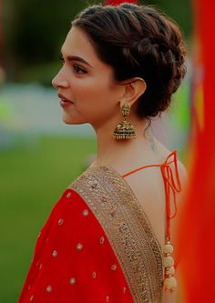 Deepika Padukone in a red saree and gorgeous braid hairstyle and jhumkis. #Bollywood fashion