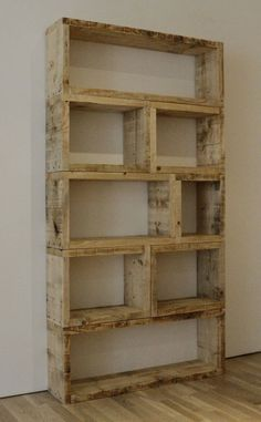 This shelving unit made of pallets could be great indoors or in a garage for storage.