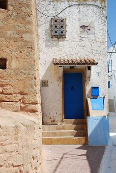 Photo I took in Morocco. Notice the tile above the door and the beautiful blue color.