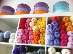 Painted tins and shelved yarns make for a marvelous show of bright, cheery colors.