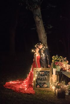 Glamorous red wedding gown and romantic fairy lights // An Elegant Farmers' Market-Inspired Engagement Shoot: Chuankai + Maureen