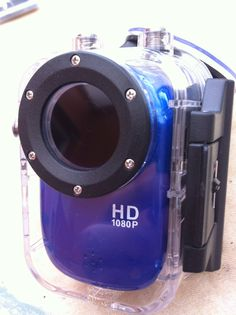 Waterproof mini HD camera, i removed the plastic lens and attached a hoya filter lens to remove glare. Hoya lens needs to be rotated to exact position.