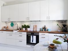 Sweet Swedish Kitchen Interior Design Ideas With White Laminated Base Kitchen Cabinets Plus Varnished Wooden Countertops Also White Wall Ceramic Tile Backsplash And White Laminated Wall Cabinets Along Round White Wooden Dining Table As Well As Interiors Designers And Top Interior Designers, Extraordinary Swedish Interior Design Ideas: Interior