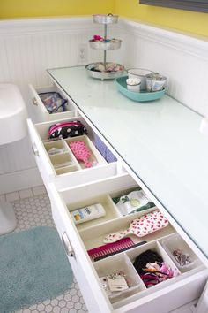 an organized kids' bathroom. Use small bins in drawers to catch hairbands and other kid stuff.