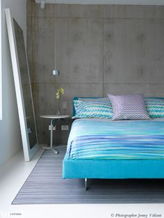 Turquoise bedding by Missoni Home brings a welcome injection of colour to this minimal bedroom.  (and the concrete wall makes it so much more interesting..)  From 'Designer's Own', a story on page 186 of Vogue Living July/Aug 2011.  Photograph by Jonny Valiant.