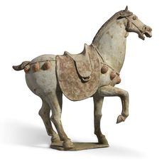 A painted pottery figure of a prancing horse, Tang dynasty, 7th-8th century