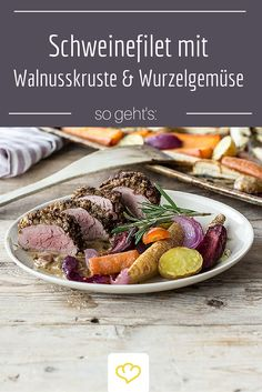 Ein tolles Gericht, wenn Gäste eingeladen sind: zartes Schweinefilet mit Walnuss-Kruste und buntem Wurzelgemüse.