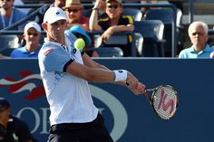 Kevin Anderson in action against Andy Murray in a men's singles fourth-round match during the 2015 US Open.