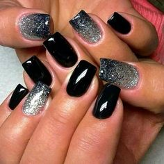 High gloss black nails and silver glitter accent nails