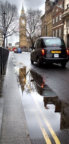 Taxi, parliament & a puddle - Great George St, London.