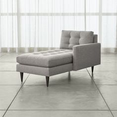 1600 Petrie is a distinct living room chaise that sits at the intersection of mid-century and today, with clean lines and tailored cushions expertly button-tufted by hand.