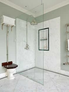A neutral colour scheme bathroom designed by @icon_architects. Our Dalby shower and Shamrock rose add a touch of understated glamour to the corner of the room. The linear drain of the shower is an elegant way of hiding the shower waste and the large alcove is perfect for storing shower essentials without compromising on space. Photographer: @alistairnicholls Bathroom Assessories, Built In Bath, London Mansion, Large Chandeliers, Neutral Color Scheme, Bath Fixtures, Shower Enclosure, Bathroom Renovations, Bathroom Ideas