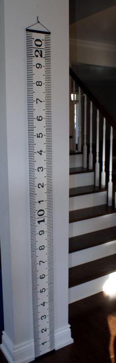 The Metric Growth Chart:  A simple digital reproduction of an old metal CM tape measure made into a full-size growth chart, printed on artist's canvas.