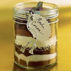 Food present and edible gifts to make for neighbors, friends and family are always a hit.  These food present Christmas treats are pictured tutorials or recipe how to's for homemade vanilla, fudge, s'mores cake in a jar, an italian feast gift basket, pancake mix, english toffee, truffles, and more...