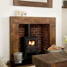 About the Grosvenor solid oak beam fire surround The Grosvenor fire surround is styled from deep sawn solid oak beams and treated with a dark tudor Rustic Fireplace Decor, Rustic Fireplaces, Wood Fireplace, Fireplace Surrounds, Fireplace Design, Fireplace Ideas, Mantel Ideas, Fireplace Poker, Ideas
