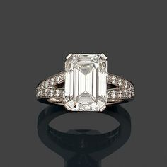 A diamond and platinum ring by Boucheron set with an emerald-cut diamond weighing 5,25 cts.