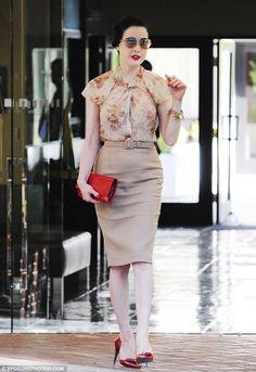 Dita    http://www.dailymail.co.uk/tvshowbiz/article-2264318/Dita-Von-Teese-looks-feminine-floral-blouse--turns-heat-sexy-red-bag-high-heels.html