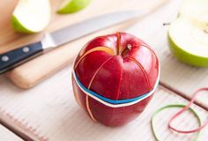Slice apples and then hold together with a rubber band to keep from drying out and browning.